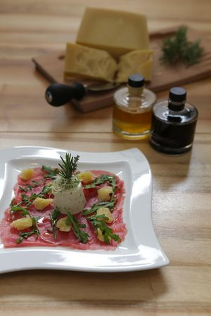 Rib-eye carpaccio with basil panna cotta